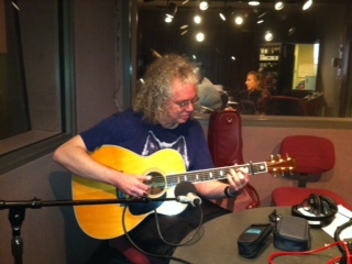 Robin Bullock plays his guitar in the WYPR studio.
